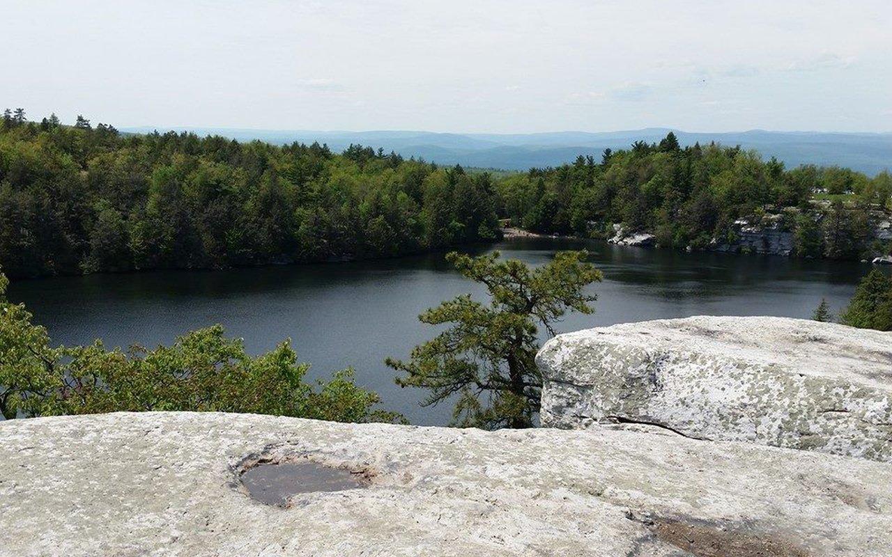 AWAYN IMAGE Hiking at Minnewaska. Lake, rock ledges, and panoramic view of Hudson valley