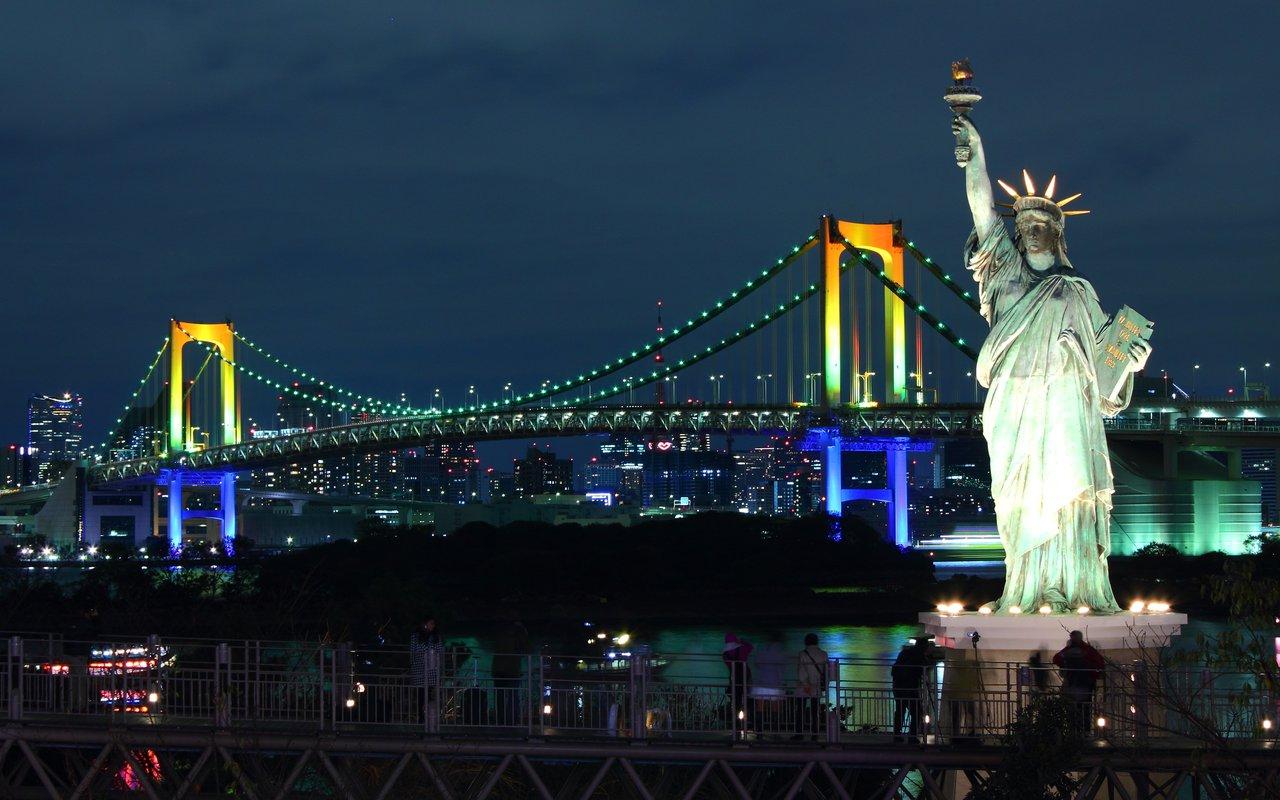 AWAYN IMAGE Walking the Rainbow Bridge at Night