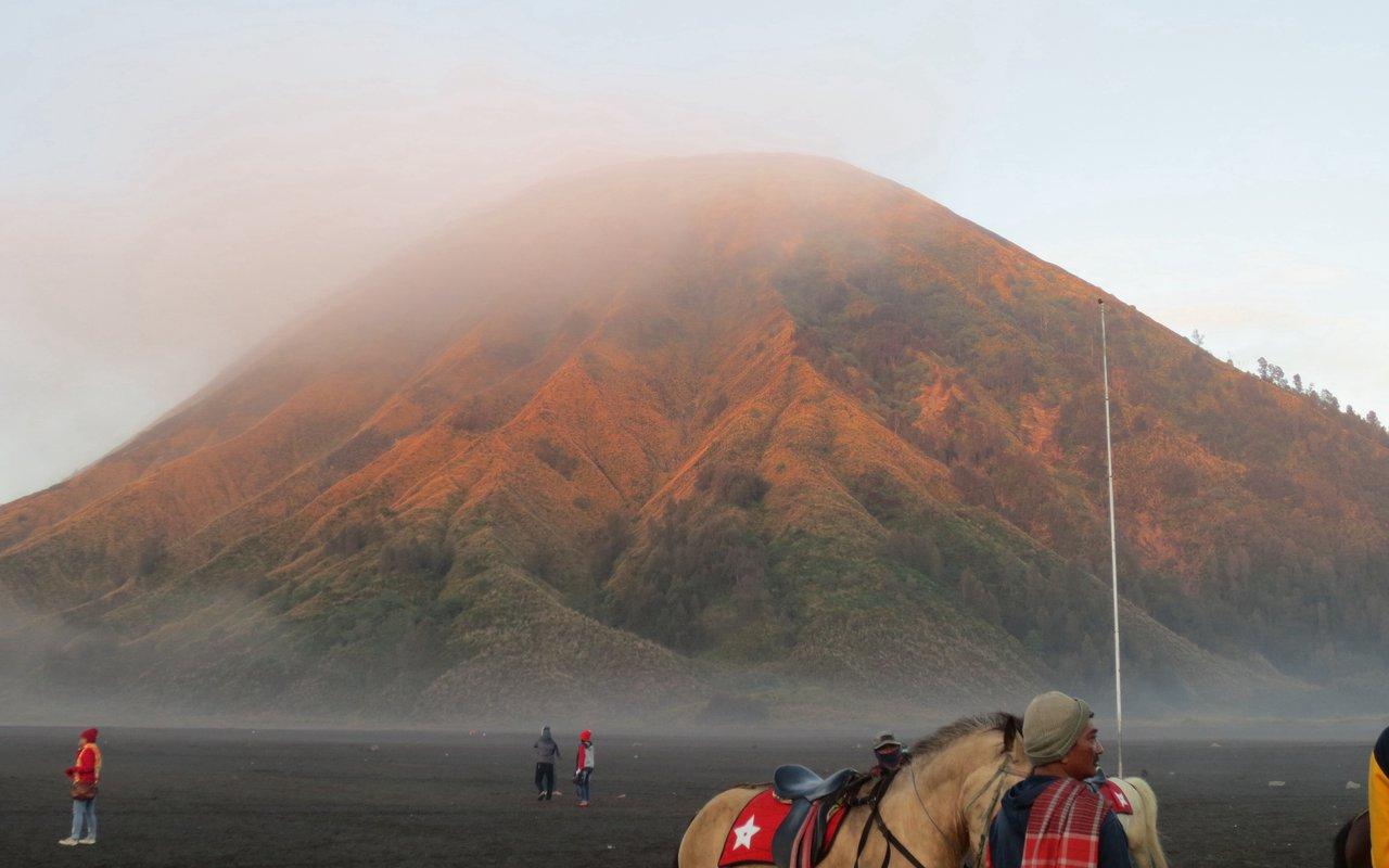 AWAYN IMAGE Hiking on an active volcano of Mount Bromo
