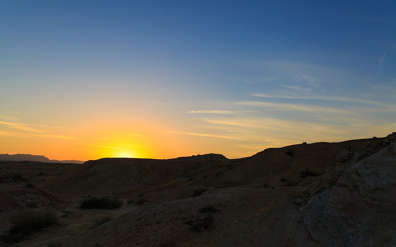 AWAYN IMAGE Watching the sunset at Big Crater Ha Makhtesh Gadol